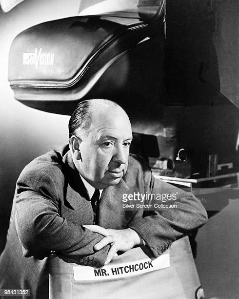 English film director Alfred Hitchcock with a VistaVision camera in a 'blimp' or soundproof casing circa 1954 Hitchcock used VistaVision between 1954...