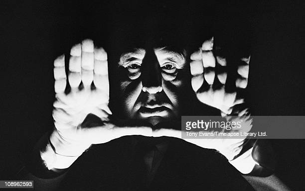 English film director and producer Alfred Hitchcock frames a shot with his hands 1964