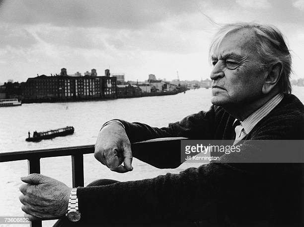 English film director and producer Sir David Lean looks out over the Thames from a balcony at his home in Limehouse, London, circa 1985.