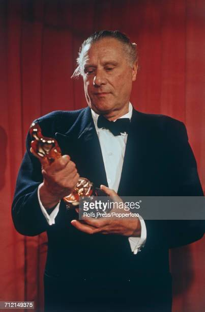 English film director Carol Reed pictured holding his Best Director Oscar statuette awarded for his film 'Oliver' at the 41st Academy Awards at the...