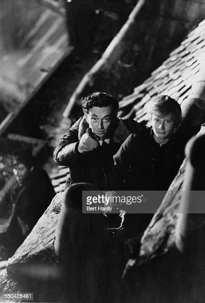 English film director David Lean directing child actor John Howard Davies in the rooftop scene in his film adaptation of 'Oliver Twist' at Pinewood...