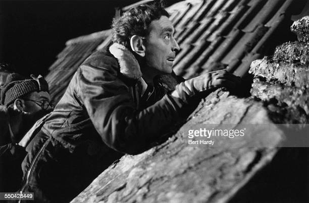 English film director David Lean directing the rooftop scene in his film adaptation of 'Oliver Twist' at Pinewood Studios, Buckinghamshire, December...