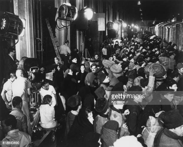 English film director David Lean is visible beneath the camera during the filming of a crowd scene for 'Doctor Zhivago' in Spain 31st August 1965 The...
