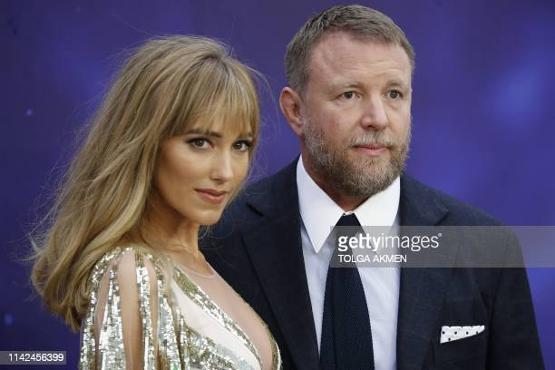 English film director Guy Ritchie and his wife Jacqui Ainsley pose on arrival for the European Gala of Aladdin in central London on May 9 2019
