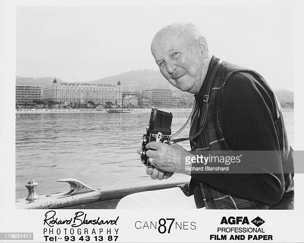 English film director Michael Powell taking pictures of the Promenade de la Croisette from a boat during the Cannes Film Festival France May 1987 The...