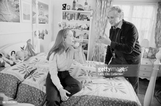 English film director Michael Winner directs actress Rachael Kelly on the set of British horror film 'Scream for Help' on 23rd November 1983