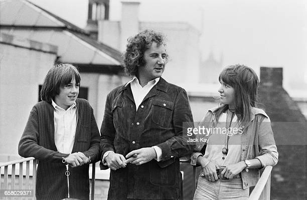 English film director Michael Winner with actors Christopher Ellis and Verna Harvey who play Miles and Flora in his film 'The Nightcomers' UK 12th...