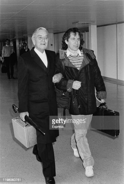 English film director, producer, screenwriter and editor David Lean and American director, producer, and screenwriter Steven Spielberg at an airport,...