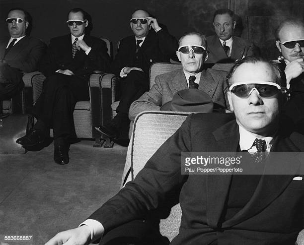 English film producer Sir Michael Balcon with colleagues at a private screening of Arch Oboler's 1952 adventure film 'Bwana Devil' London 1953 'Bwana...