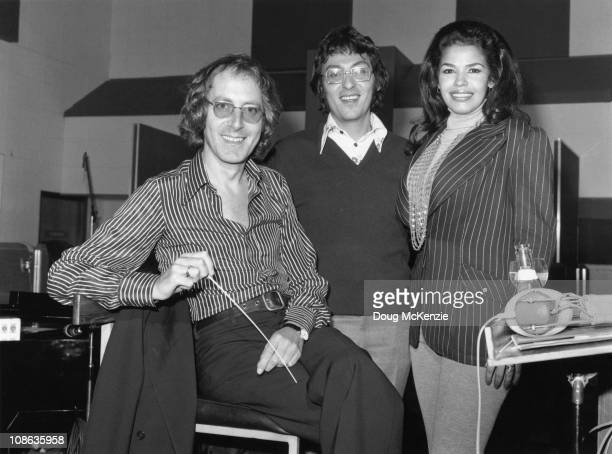 English film score composer John Barry with lyricist Don Black and Australian singer Wilma Reading, November 1973.