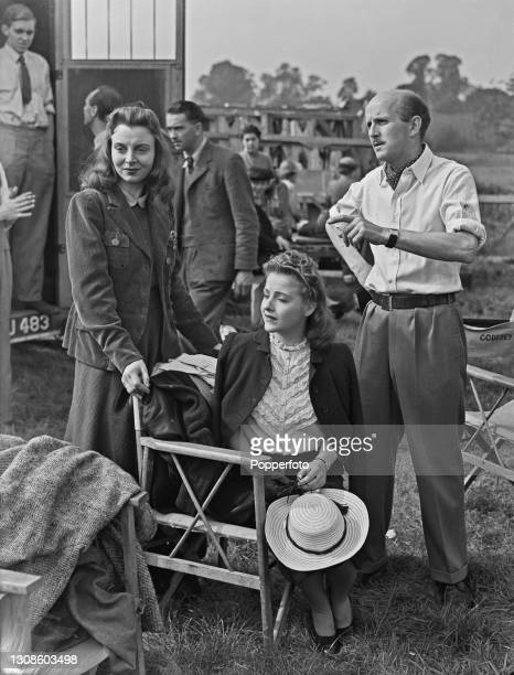 English filmmaker Michael Powell instructs actresses Pamela Brown , on left, and Joyce Redman , seated, on direction in an upcoming scene during...