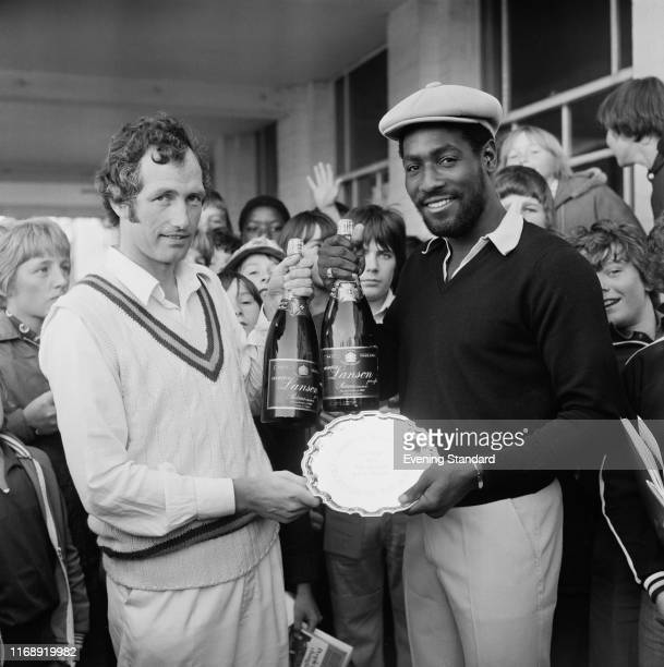 English first-class cricketer Mike Smedley hands to Antiguan cricketer Viv Richards his silver plate prize for 'Evening Standard, Cricketer of the...