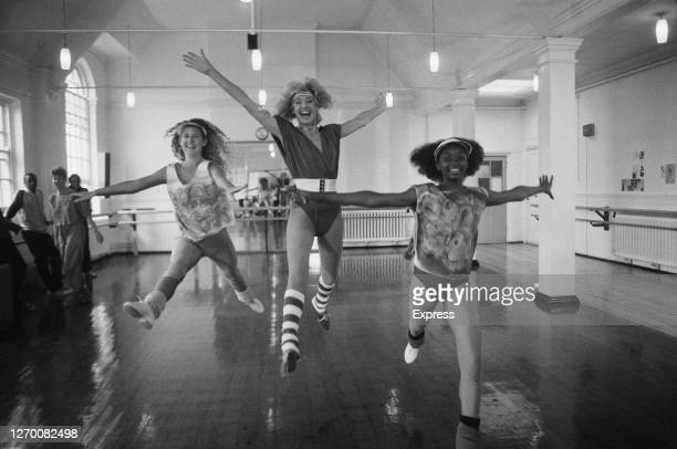 English fitness expert Diana Moran with her dance group, 15th June 1985.