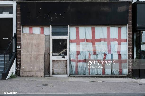 english flags covering abandoned storefront, margate, england - shop stock pictures, royalty-free photos & images