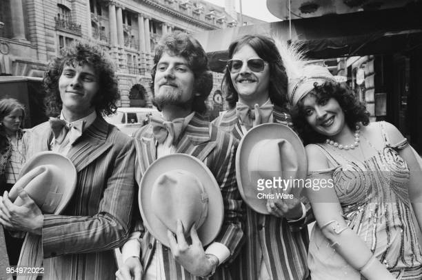 English folk group The Settlers pose on Regent Street in London during a press reception at the Cafe Royal to mark the launch of their record 'Top of...