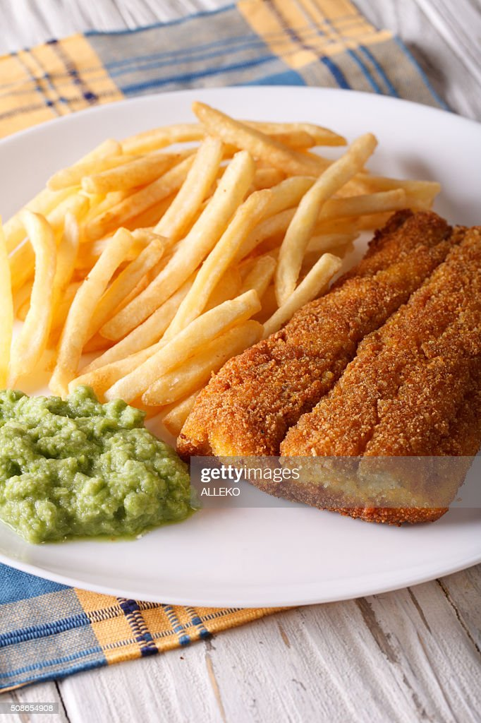 English food: fried fish fillets and chips close-up on plate. : Stock Photo