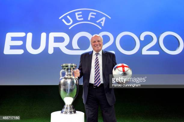 English Football Association Chairman Greg Dyke poses with the trophy and ball after London were chosen to host the final and semifinals of the EURO...