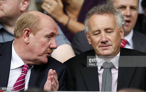 English Football Association chief executive Brian Barwick speaks to Liverpool FC's chief executive Rick Parry before the English Premier League...