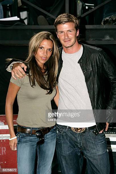 English football captain David Beckham and his wife Victoria attend 'Live 8 London' in Hyde Park on July 2 2005 in London England The free concert is...