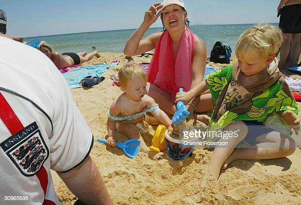English football fans are seen relaxing with their family at the beach on June 16, 2004 in Albufeira, Portugal. While a small minority of the England...