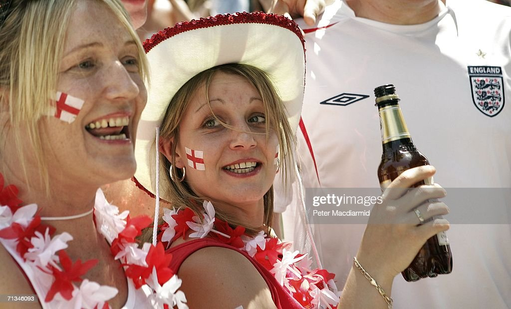 English football fans drink a beer ahead of their team's quarter final match with Portugal on July 1, 2006 in Gelsenkirchen, Germany.