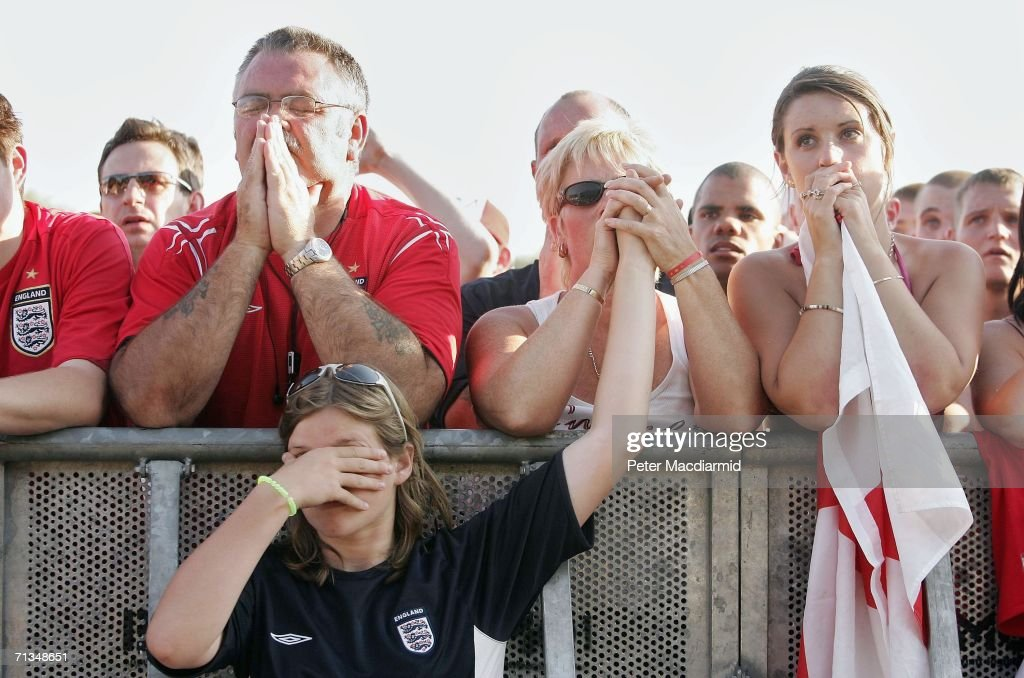 English football fans watch as England lose to Portugal on penalties in the quarter finals of the FIFA World Cup 2006 on July 1, 2006 in Gelsenkirchen, Germany. Thousands of fans watched the match on large outdoor screens.