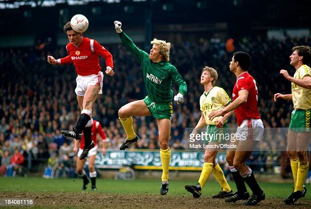 English Football League Division One - Norwich City v Manchester United, Kevin Moran rises above Chris Woods to head home into the Norwich goal.