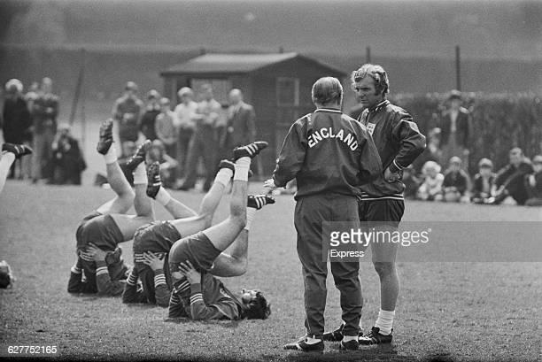 English football manager Alf Ramsey with Bobby Moore and the England football team during training at Roehampton UK April 1971