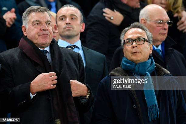 English football manager Sam Allardyce takes his place in the stands next to Everton's Iranian owner Farhad Moshiri to watch the English Premier...