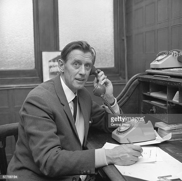 English football manager Vic Buckingham working at his desk at Fulham FC's Craven Cottage ground 25th January 1965