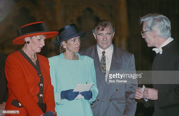 English football player and manager Malcolm Allison at a memorial service for English footballer Bobby Moore with Moore's second wife Stephanie...