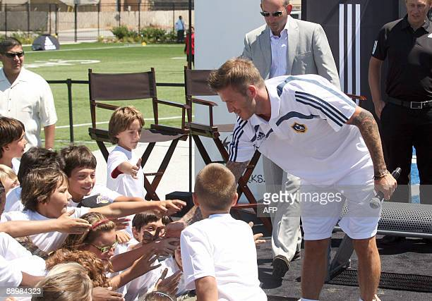 English football player David Beckham talks with kids during the press conference to announce 'a new nationwide community initiative to inspire and...