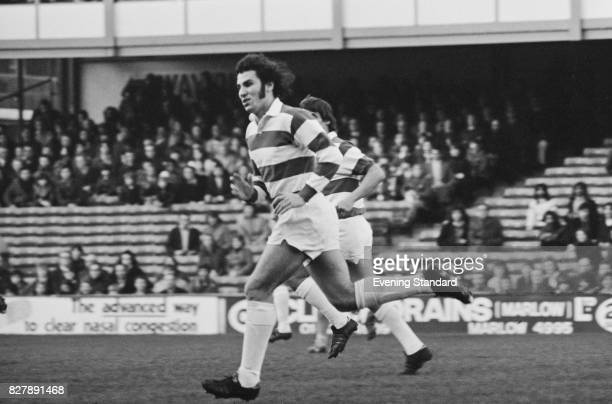 English football player Gerry Francis of Queens Park Rangers FC in action during a match against Burnley FC London 11th January 1975