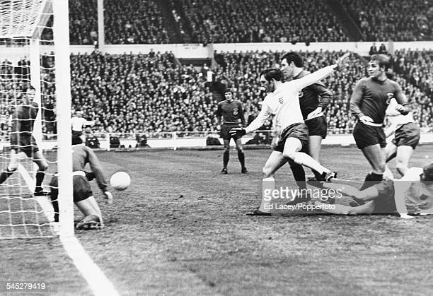 English football player Jeff Astle scores a goal against the Welsh National team at Wembley Stadium London May 7th 1969