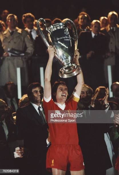 English footballer and captain of Liverpool FC Phil Thompson lifts up the European Cup trophy in celebration after Liverpool beat Real Madrid 10 in...