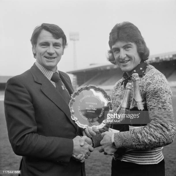 """English footballer and football manager Bobby Robson hands the """"Evening Standard Footballer of the Month"""" prize to English football player and..."""