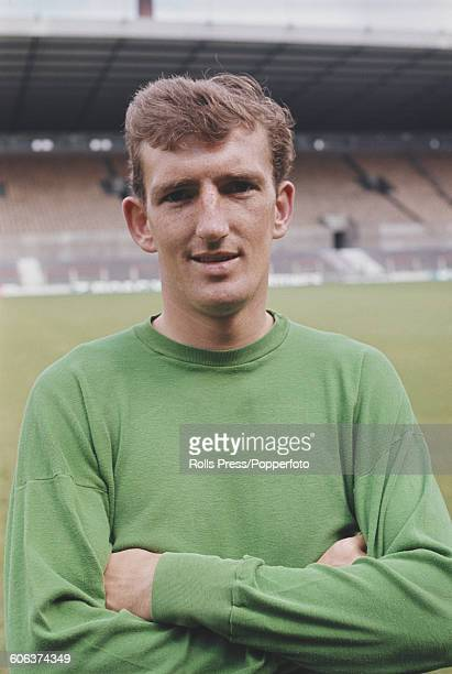 English footballer and goalkeeper with Manchester United Football Club Alex Stepney posed on the pitch at United's Old Trafford stadium in Manchester...