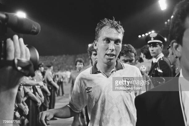 English footballer and goalscorer, David Platt pictured leaving the pitch at the end of the Group of 16 match between England and Belgium in the 1990...