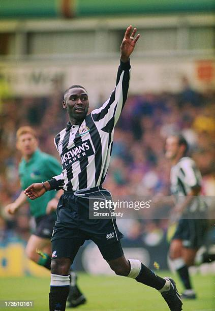 English footballer Andrew Cole of Newcastle United celebrates his goal against Aston Villa during an English Premier League match at Villa Park...