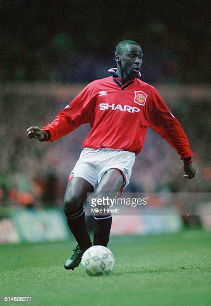 English footballer Andy Cole playing for Manchester United against Blackburn Rovers in an English Premier League match at Old Trafford Manchester...