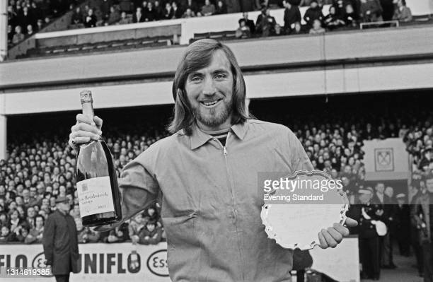 English footballer Billy Bonds of West Ham United FC is awarded the Evening Standard Footballer of the Month trophy and a bottle of Charles Heidsieck...