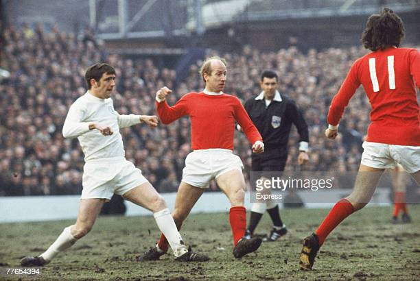 English footballer Bobby Charlton of Manchester United FC in action against Leeds United circa 1970 On the left is Leeds player Norman Hunter