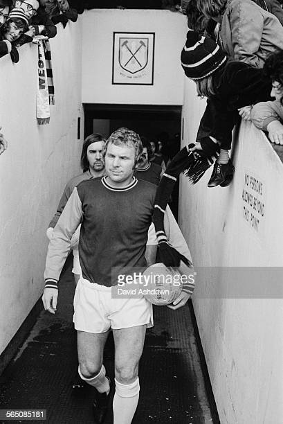 English footballer Bobby Moore leads the West Ham reserves onto the pitch before a match against Plymouth Argyle reserves at West Ham's Boleyn Ground...