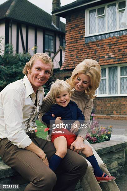 English footballer Bobby Moore of West Ham United at home with his wife Tina and their son Dean circa 1970