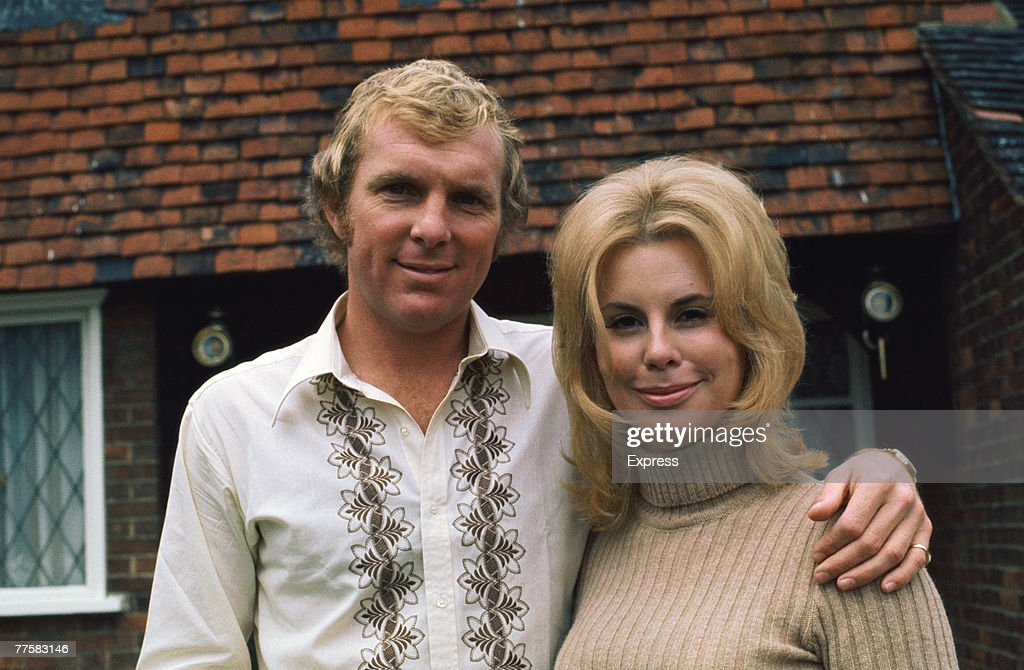 English footballer Bobby Moore (1941 - 1993) of West Ham United, at home with his wife Tina, circa 1970.