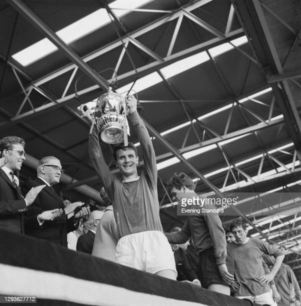 English footballer Brian Labone of Everton FC holds up the FA Cup after the final against Sheffield Wednesday at Wembley Stadium, London, UK, 14th...