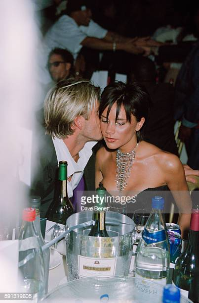 English footballer David Beckham and his wife, singer Victoria Beckham of the Spice Girls, during the MOBO Awards at the Royal Albert Hall in London,...