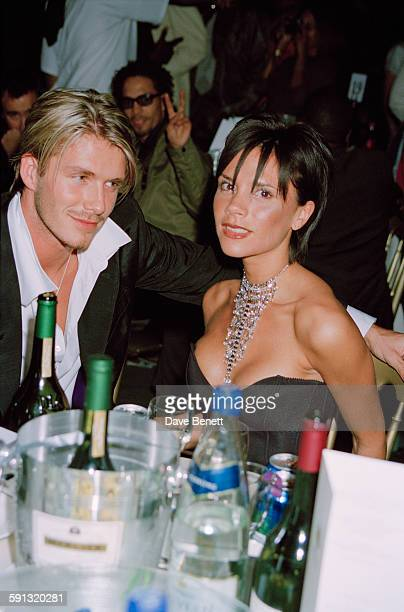 English footballer David Beckham and his wife singer Victoria Beckham of the Spice Girls during the MOBO Awards at the Royal Albert Hall in London...