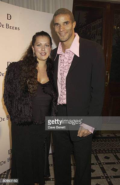 English Footballer David James and his wife attends the De Beers London Store Opening Party at The In and Out Club on November 22, 2002 in London.