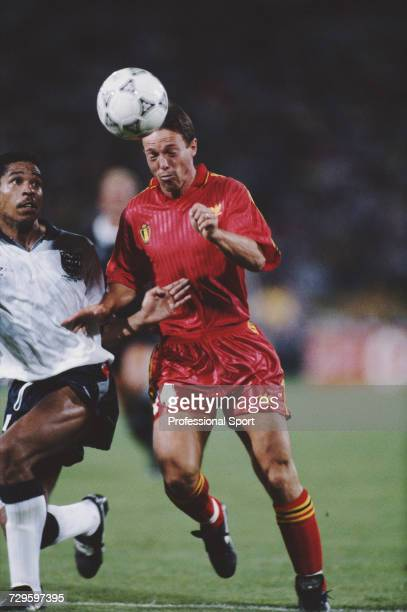 English footballer Des Walker prepares to tackle Belgium player Nico Claesen for the ball during the Round of 16 match between England and Belgium in...